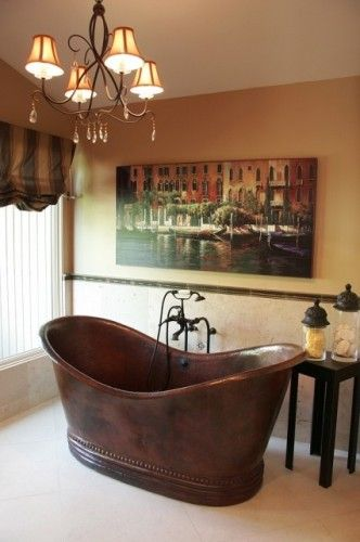 copper bathtub black wrought iron chandelier artistic painting