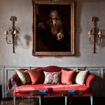 Deep Red Sofa Colorful Throw Pillows Great Wall Art With Well Carved Gold Frame A Couple Of Victorian Style Wall Sconces