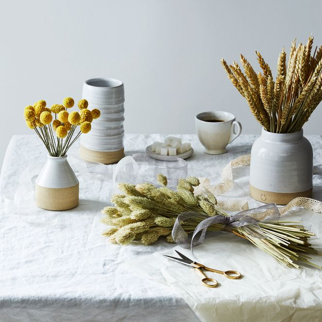 dried floral arrangements on ceramic vases
