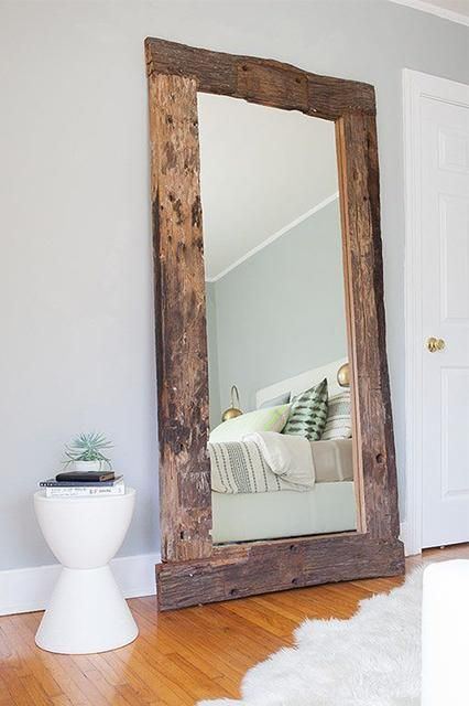 giant mirror with rustic wood frame