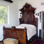 Grand Victorian Style Bed Furniture With Detailed Shape And Carvings Woven Bench Bed Wood Floors White Wall Painting