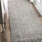Handmade Knitted Wool Runner In Pale Gray Woven Pouf In Light Gray Wood Floors