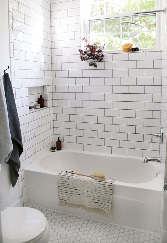 in white bathroom design white subway tile walls white hexagon tile floors built in bathtub in white
