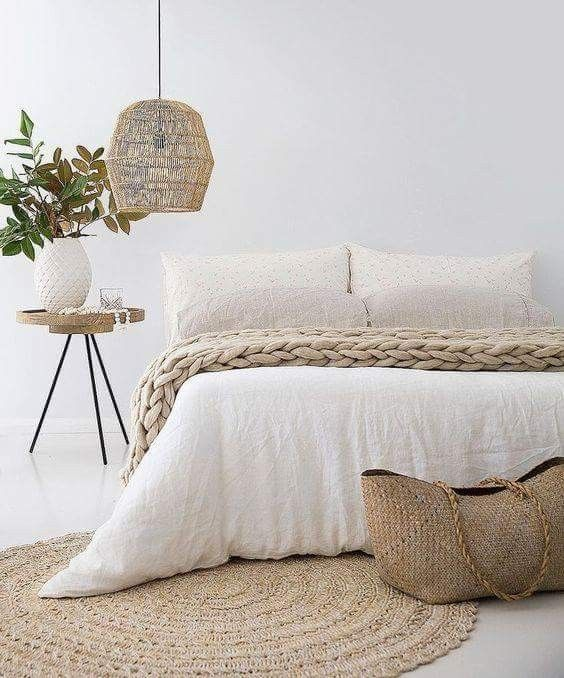 light neutral woven rug decorative woven bag woven wool blanket tripod leg bedside table with round top pendant with woven lampshade