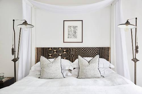 minimalist bedroom idea minimalist throw pillows bed frame with dark printed headboard a couple of floor lamps