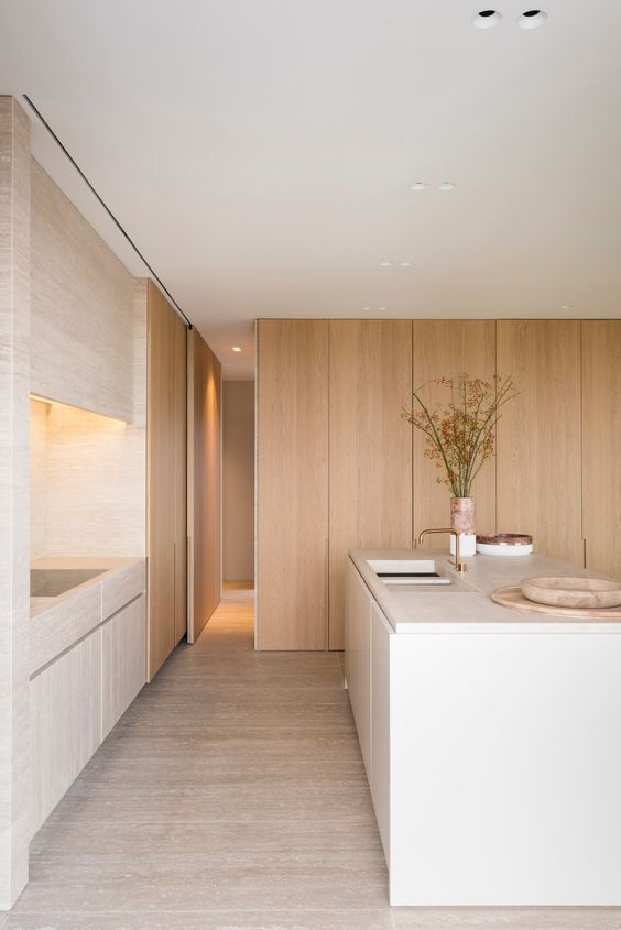 minimalist kitchen idea full height wooden walls purely white kitchen island with undermount sink light wood floors