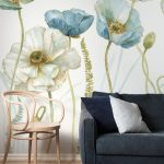Oversized Flower Print Wallpaper Soft Pink Chair Deep Gray Couch With White And Deep Gray Throw Pillows