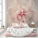Oversized Rose Wallpaper In Soft Pink Soft Pink Bed Linen And Pillows White Duvet Whitewashed Wood Board Floors