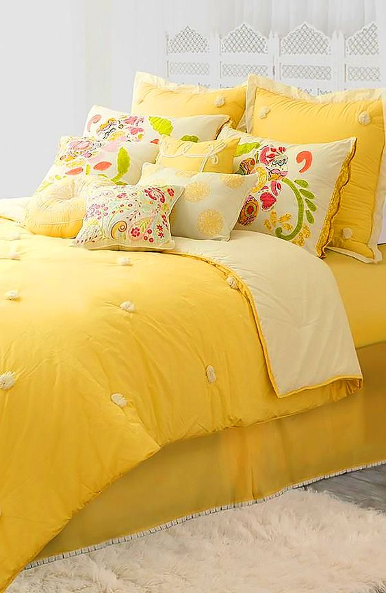 pop of yellow bedding with colorful floral print pillows