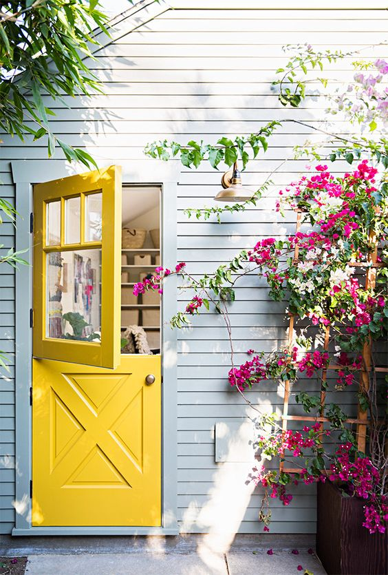 pop of yellow colored dutch door idea