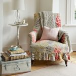 Reading Corner Idea Vintage Reading Chair With Floral Prints Suitcase Table Round Top Side Table With Table Lamp