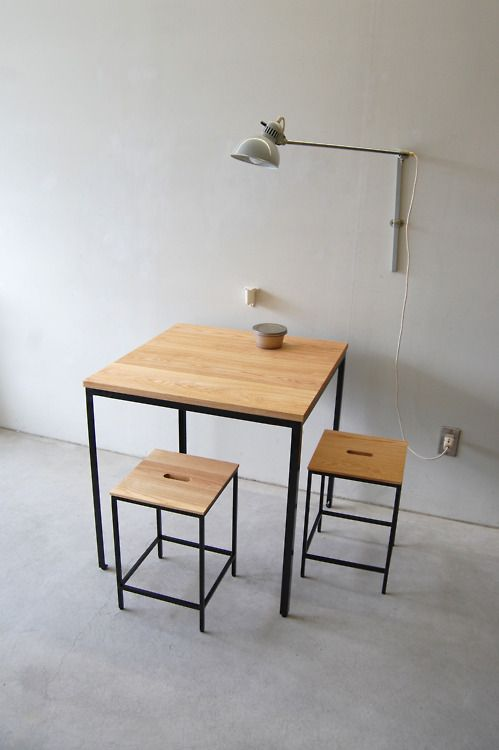 smart furniture idea wood top dining table with metal legs wood top stool with metal legs wall sconce white floors and walls