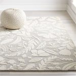 Textured Floral Rug In Soft Gray Woven Pouf In White Light Gray Wood Floors