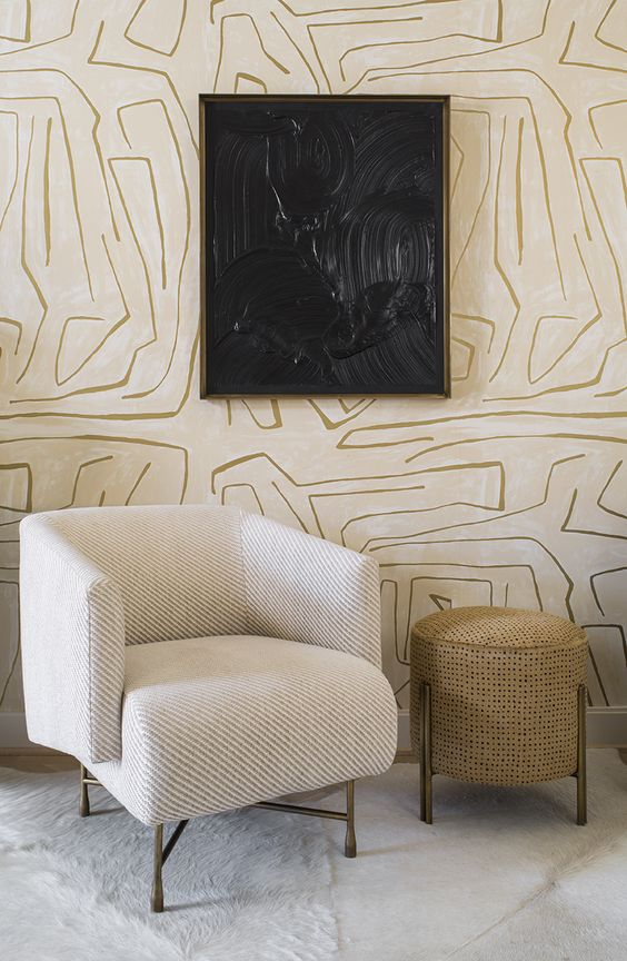 wallpaper with modern patterns black wall art with frame white chair light brown side table with brass leg