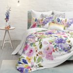 Watercolor Style Bedding With Floral Patterns White Painted Concrete Walls Round Top Side Table In White