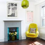 Yellow Pop Corner Chair With Layered Colors Throw Pillow Herringbone Hardwood Floors Lemon Green Pendant Carved Fireplace Monochromatic Wall Art With White Frame