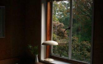 bedroom with medium sized glass window as mini belvederes