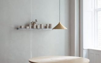 beige hued space round top table with beige base round top stoles in whitewashed and beige color pendant