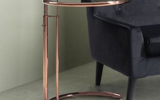 end table with rose gold finish and black glass top in round shape