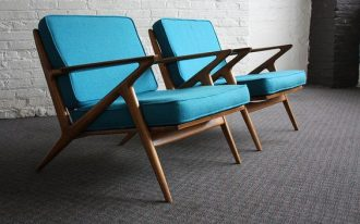 midcentury modern chairs with radiant blue upholstery cover and wood finish structure