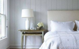 minimalist bedroom idea textured comforter in white vintage style area rug vintage style bedside table white table lamp