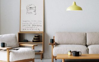 minimalist living room idea wood structured couch with fluffy upholstery wood coffee table small bookcase made of wood simple pendant with pale yellow lampshade