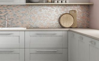 modern minimalist kitchen idea copper mosaic tile backsplash white cabinetry concrete tile floors copper lampshaded pendant