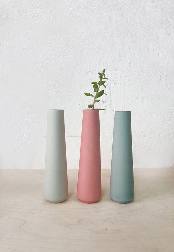 ornate ceramic vases in soft colors