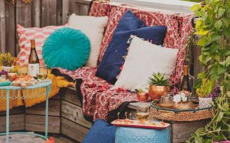 Bohemian style rooftop with worn textile accents
