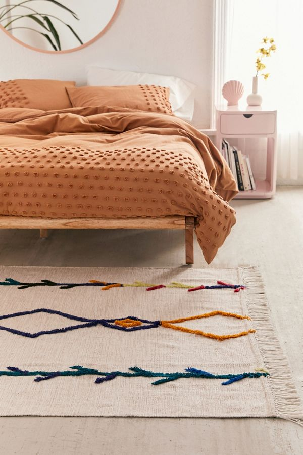 Faiza area rug in white with textured patterns as the accents