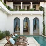 Spanish Colonial Exterior Idea With Curved Doors White Stucco Exterior Walls