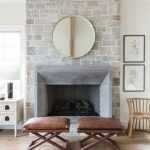 Centered Fireplace With Stoned Wall Panel A Couple Of X Base Stools With Leather Upholstery
