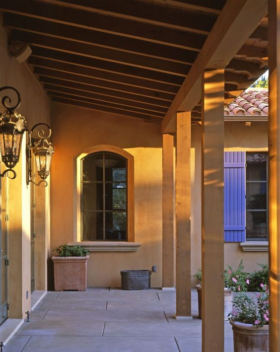 corridor connecting two stories of Spanish colonial exterior