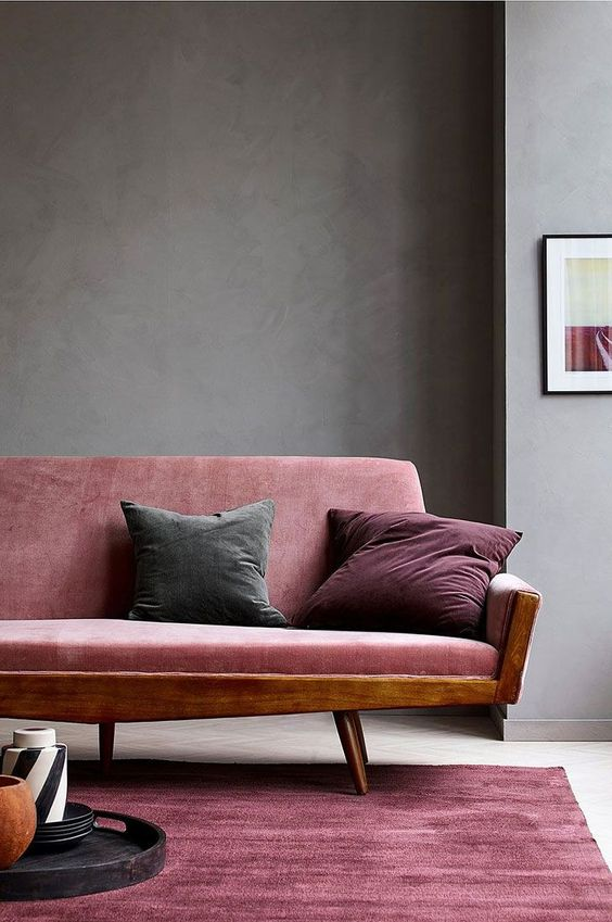 dark pink velvet couch with wood structure dark pink velvet area rug solid gray wall paint