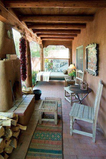 exposed wood beams wood ceilings bare stucco exterior walls terracotta floors vintage runner