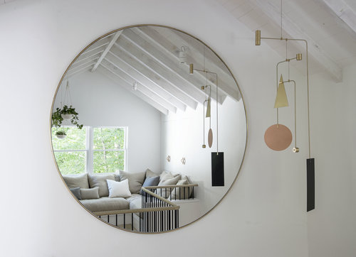 huge wall mirror in round shape with brass frame