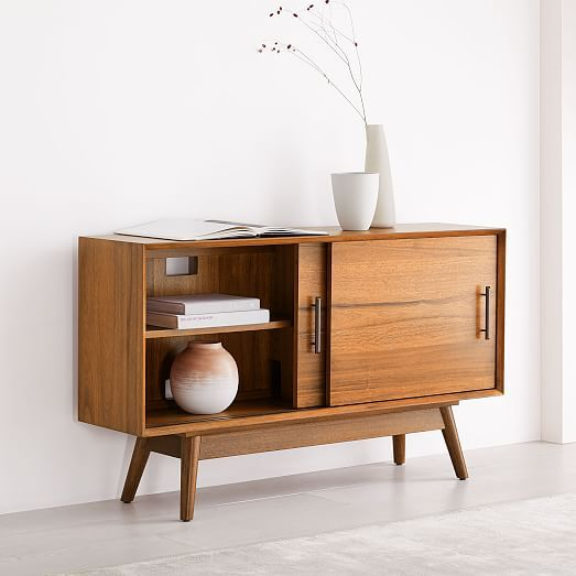 midcentury console made of wood with tapered legs and angled face