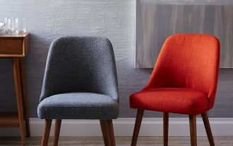 midcentury modern chairs in red and gray with angled wood legs