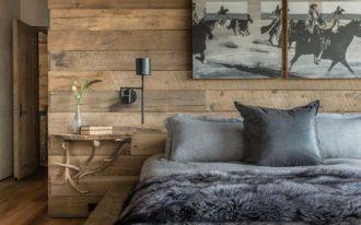 modern rustic bedroom design reclaimed wood wall platform bed frame gray bedding wall mounted bedside tables
