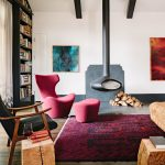 Modern Rustic Living Room Midcentury Modern Armchair In Red With Table Wood Structured Chair With Dark Upholstery Taller Bookcases Dark Red Area Rug Suspended Fireplace