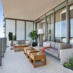 Modern Style Balcony Modern Couches In Gray White Throw Pillows Wood Coffee Tables Gray Stoned Floors Modern Balcony Railing System