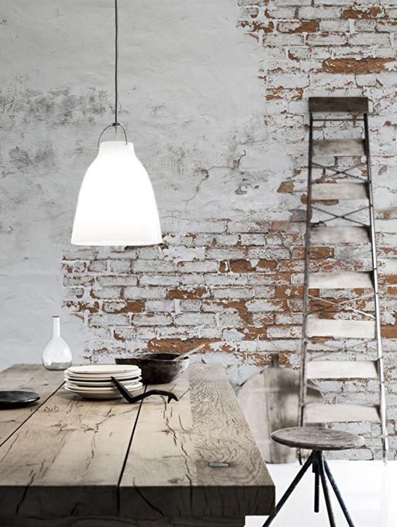 ornate metal ladder washed dining table angled leg stool whitewashed brick walls low level pendant