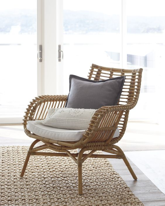 rattan chair with throw pillows and mattress knitted area rug