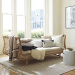 Rattan Daybed With Throw Pillows Tufted Upholstery And Throw Blanket