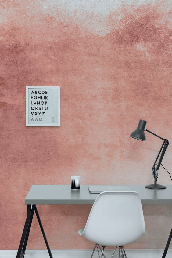 textured splashes of pink accent color on wall gray top working table midcentury modern working chair in white modern table lamp in black
