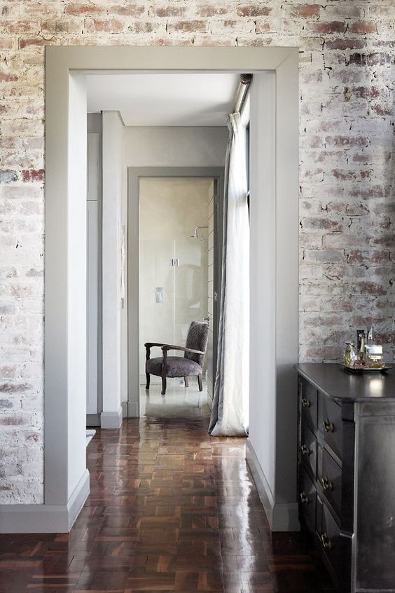 whitewashed bricks wall system gray door trims brick shape wood floors