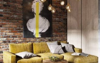 worn like couch in yellow wood top industrial coffee table exposed brick walls barely concrete floors and walls