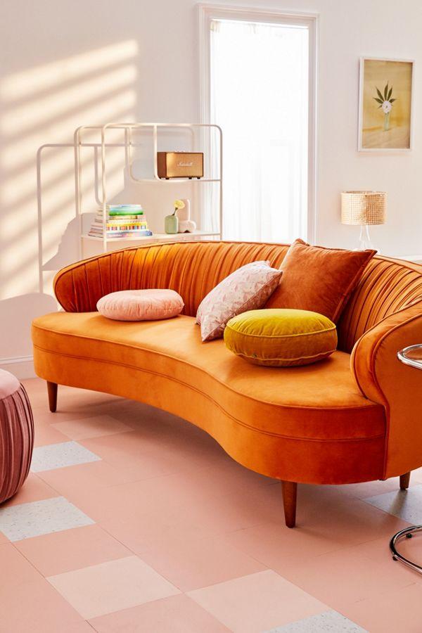 Camila velvet sofa in terracotta throw pillows pink area rug