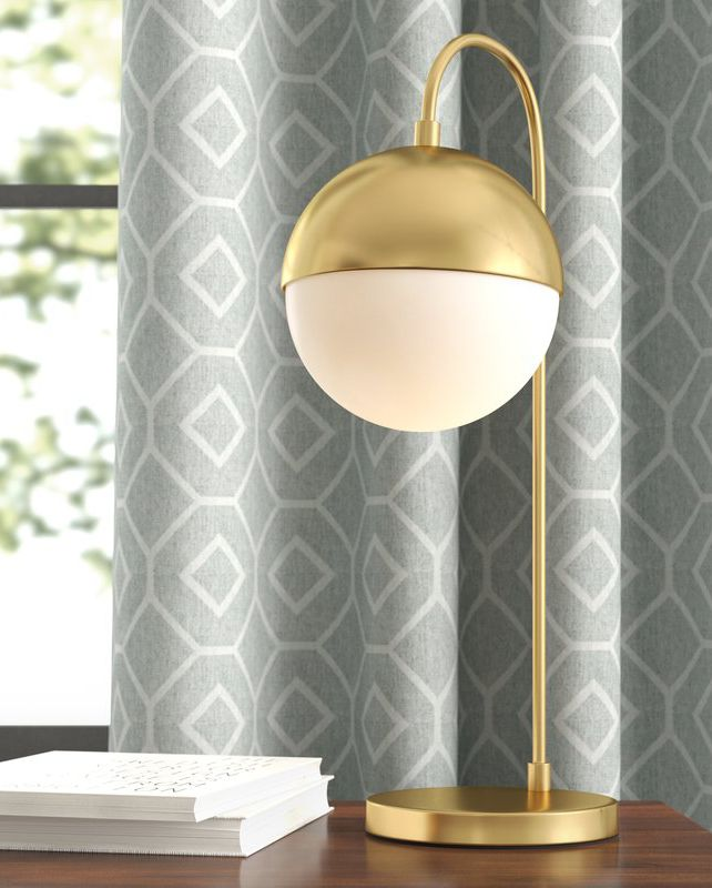 Jaydon desk lamp with gold finish metal base and white bulb
