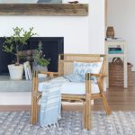 Rattan Armchair With White Cushion By Serena And Lily Throw Blanket In Blue Area Rug In Blue And White